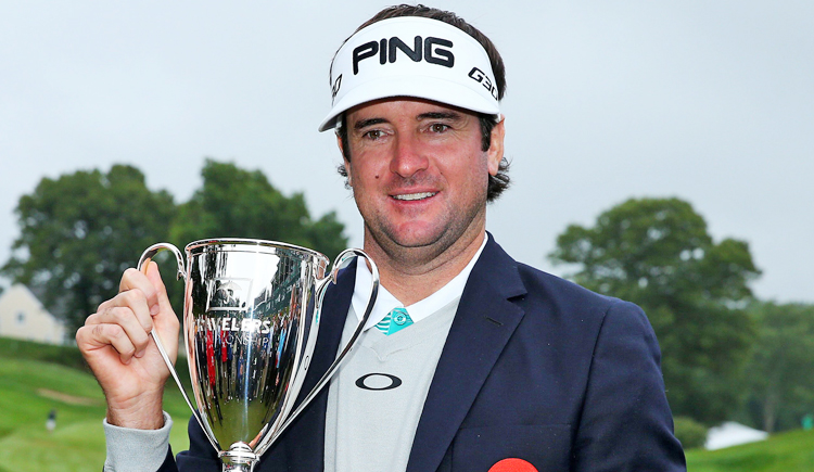 Bubba Watson holds the trophy after winning the Travelers Championship at TPC River Highlands on Sunday. Photo: AFP