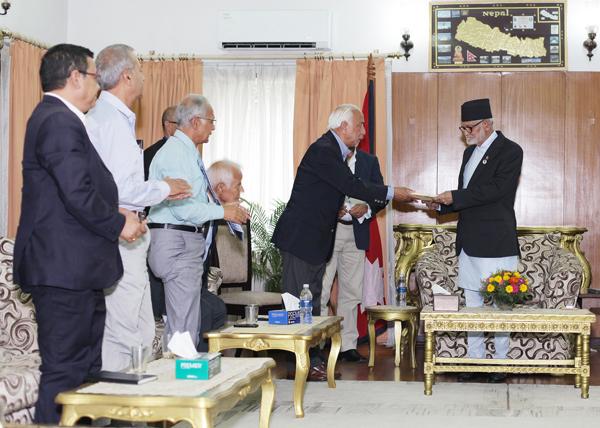 Kedar Bhakta Mathema presenting report to Prime Minister Sushil Koirala at the latteru0092s nofficial residence, in Baluwatar, Kathmandu, on Monday, June 29, 2015. nPhoto: RSS