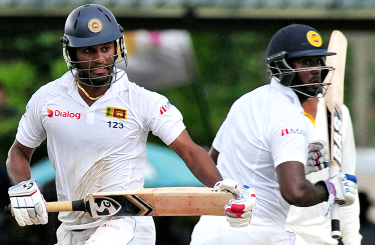 Sri Lanka's Dimuth Karunaratne (left) and Angelo Mathews run between the wickets during the final day of their second Test match against Pakistan in Colombo on Monday. Photo: AFP