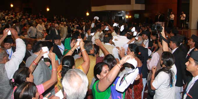 Lawmakers of Madhesi parties protesting and taring copies of the preliminary draft of new constitution. Photo: RSS