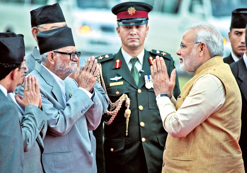 Nepal's Prime Minister Sushil Koirala (left) and Indian Prime Minister Narendra Modi greet each other at the Tribhuvan International Airport in Kathmandu on August 5, 2014, before Modi left for New Delhi, completing his two-day official Nepal visit. Photo: RSS/File