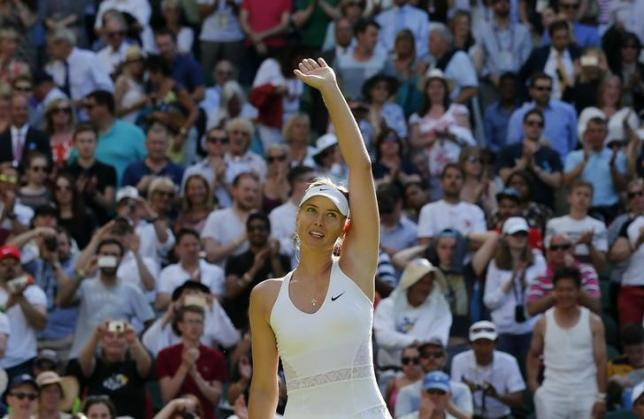 Maria Sharapova of Russia celebrates after winning her match against Johanna Konta of Britain at the Wimbledon Tennis Championships in London, June 29, 2015. REUTERS/Suzanne Plunkett
