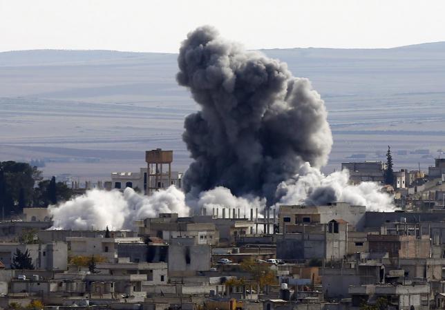 An explosion following an air strike is seen in western Kobani neighbourhood, November 23, 2014.  REUTERS/Osman Orsal