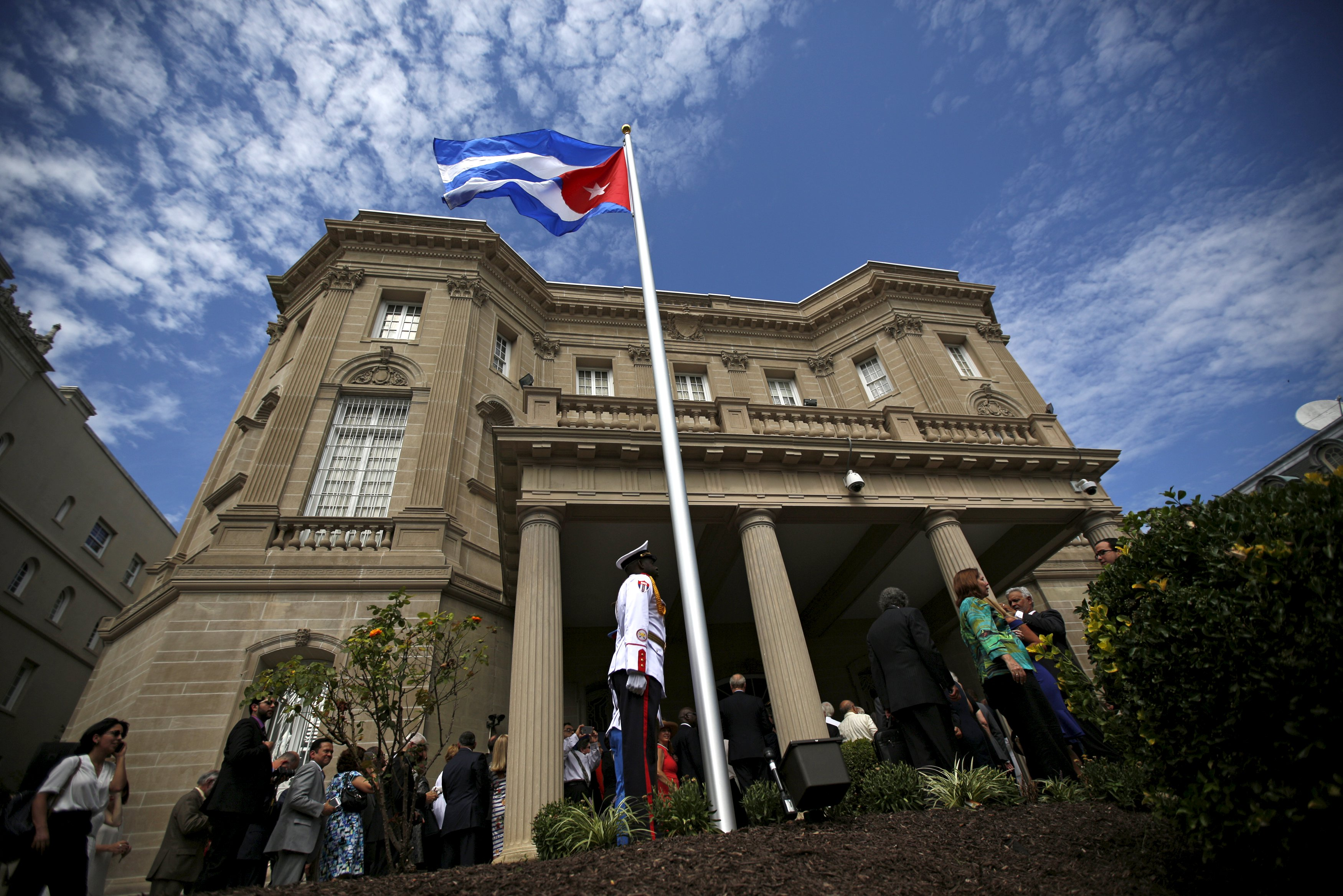 A guard stands in front of the new Cuban embassy in Washington after officials raised the national flag in a ceremony, July 20, 2015. The Cuban flag was raised over Havanau2019s embassy in Washington on Monday for the first time in 54 years as the United States and Cuba formally restored relations, opening a new chapter of engagement between the former Cold War foes. Photo: Reuters