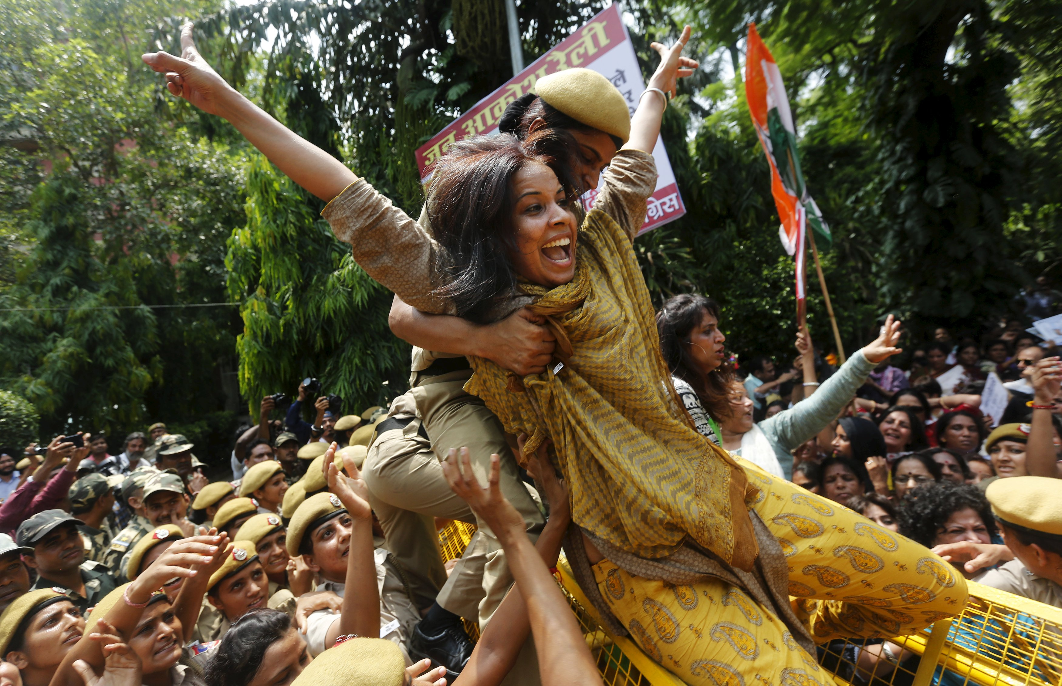 A policewoman trying to stop a member of the All India Mahila Congress, the women's wing of the Congress party, who was trying to cross over a barricade, during a protest against Indian Prime Minister Narendra Modi in New Delhi, on Tuesday. Photo: Reuters