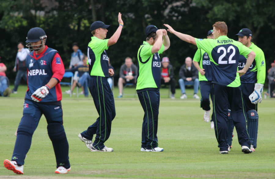 Ireland players celebrate the wicket as Nepalu2019s Sharad Vesawkar walks back to the pavilion during their Group A match of the ICC World Twenty20 Qualifiers in Stormont, Belfast on Monday.