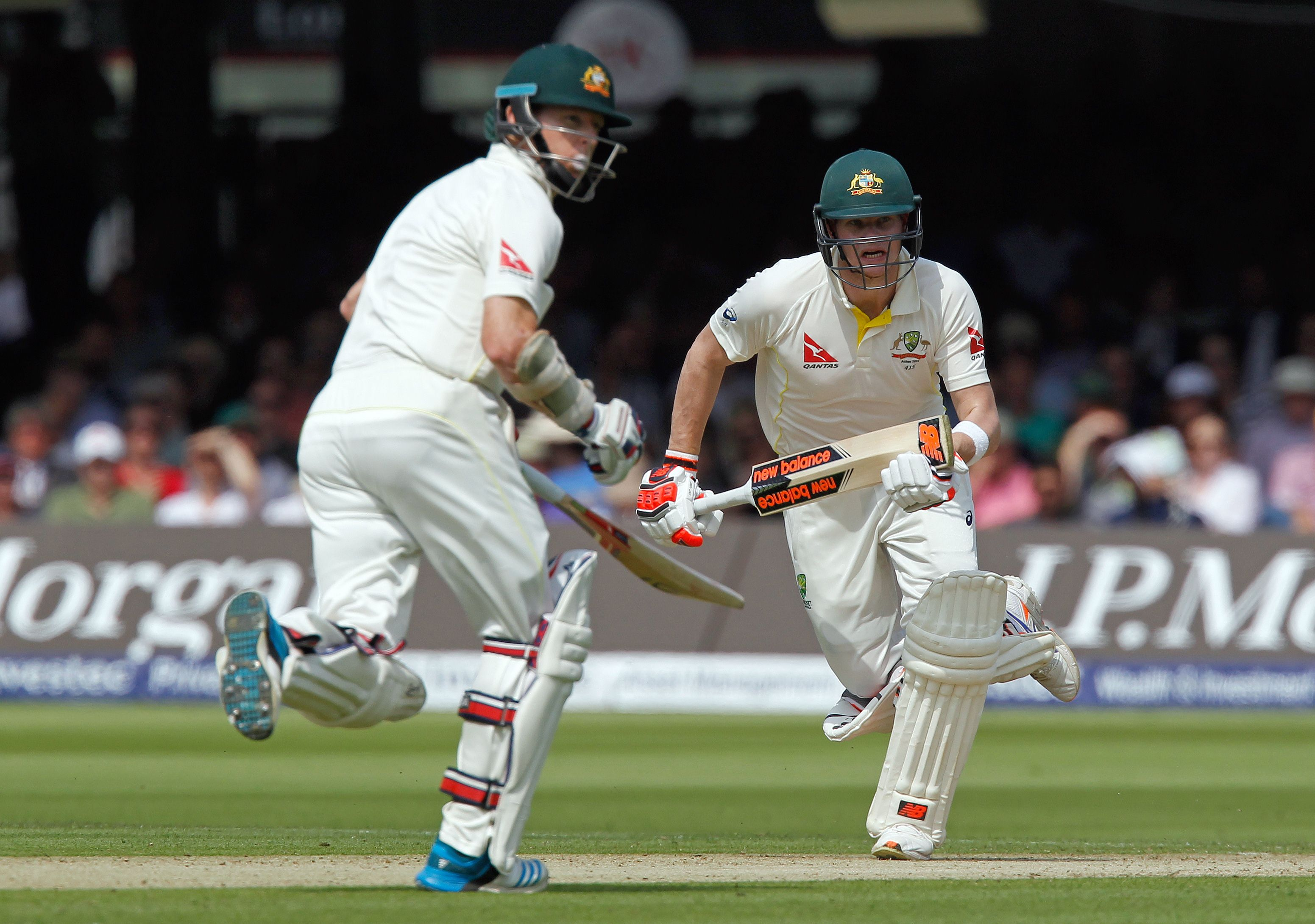 Australiau2019s Steven Smith (right) and his teammate Chris Rogers run between the wickets during the first day of their second Ashes Test match against England in London on Thursday. Photo: Reuters