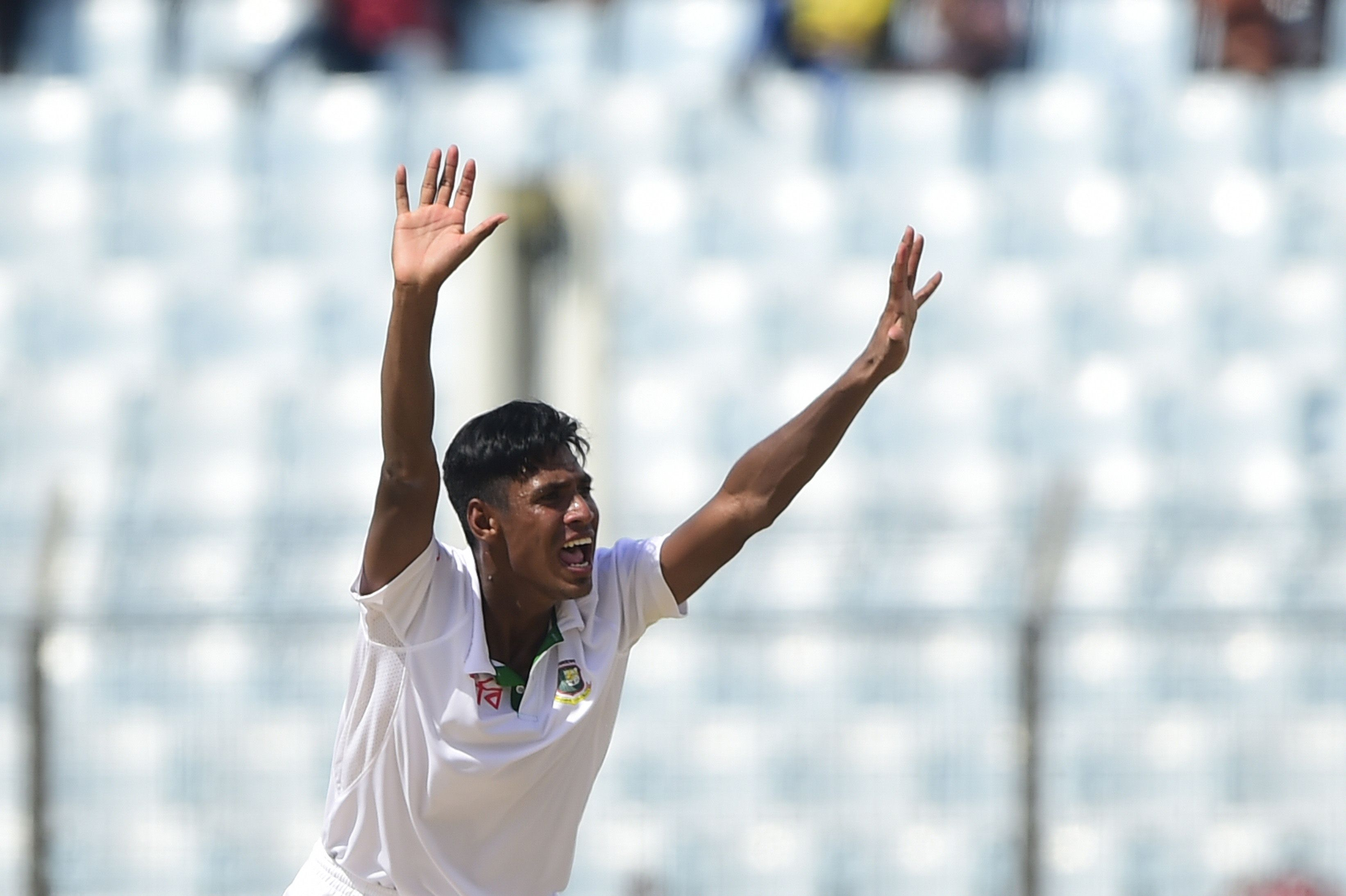 Bangladesh cricketer Mustafizur Rahman appeals successfully for leg before wicket decision against South Africa cricketer Jean-Paul Duminy during the first day of the first Test match between Bangladesh and South Africa at the Zahur Ahmed Chowdhury Stadium in Chittagong on July 21, 2015. AFP PHOTO/ Munir uz ZAMAN