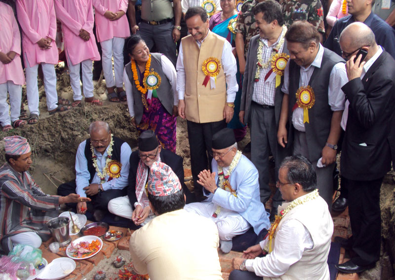 Chiefs of Nepali Congress, CPN-UML, UCPN-Maoist and Madhesi Janaadhikar Forum-Democratic lay a foundation stone for a convention hall being built in the name of late NC leader Girija Prasad Koirala, in Bhadrapur of Jhapa, on Monday, July 13, 2015. Photo: RSS