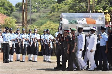 Tri-services personnel carry the body of former Indian president A.P.J Abdul Kalam at Mandapam Helipad ground in Rameswaram, India, Wednesday, July 29, 2015. Kalam, known as the father of the country's military missile program, died Monday after collapsing while delivering a lecture. He was 83. AP