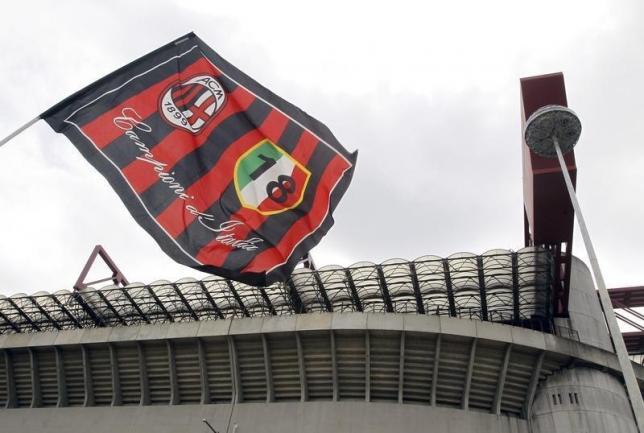 AC Milan's flag waves in front of San Siro stadium in Milan April 29, 2015. REUTERS/Alessandro Garofalo/Files