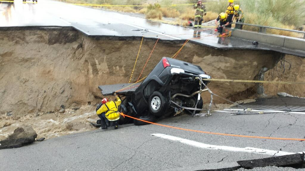 In this photo provided by the California Fire/ Riverside County Fire Department, emergency crews respond after a pickup truck crashed into the collapse of an elevated section of Interstate 10, Sunday, July 19, 2015, in Desert Center, California. The bridge, which carries the eastbound interstate about 15 feet above a normally dry wash, snapped and ended up in the flooding water below, the California Highway Patrol said, blocking all traffic headed toward Arizona. Photo: California Fire/ Riverside County Fire/ AP
