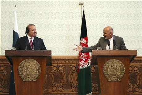 In a May 12, 2015 file photo, Afghan President Ashraf Ghani, right, speaks as Pakistani Prime Minister Nawaz Sharif listens during a joint press conference at the presidential palace in Kabul, Afghanistan. Pakistan said Wednesday, July 8, 2015, that the first official face-to-face discussions between Afghan government officials and the Taliban have made progress, with the two sides agreeing at a meeting near Islamabad to work on confidence-building measures and hold more such talks after the Muslim holy month of Ramadan. AP