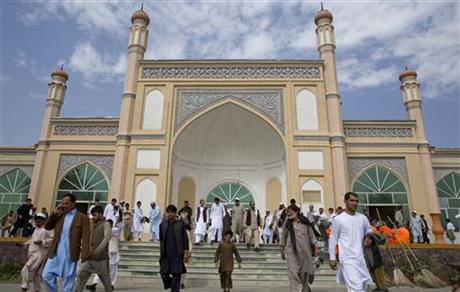 Afghan men leave after Eid Al-Fitr prayers in Eid Gah mosque in Kabul, Afghanistan, Friday, July 17, 2015. Eid al-Fitr prayer marks the end of the holy fasting month of Ramadan.AP