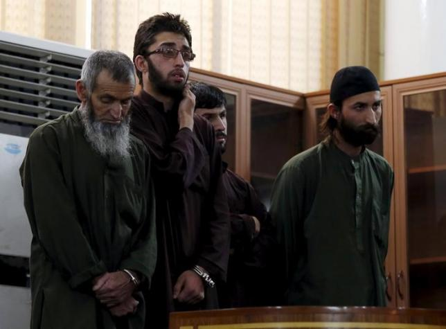 Four Afghan men look on in court during their trial in connection with the killing of a 27-year-old woman, in Kabul, Afghanistan May 6, 2015. Photo: Reuters/File