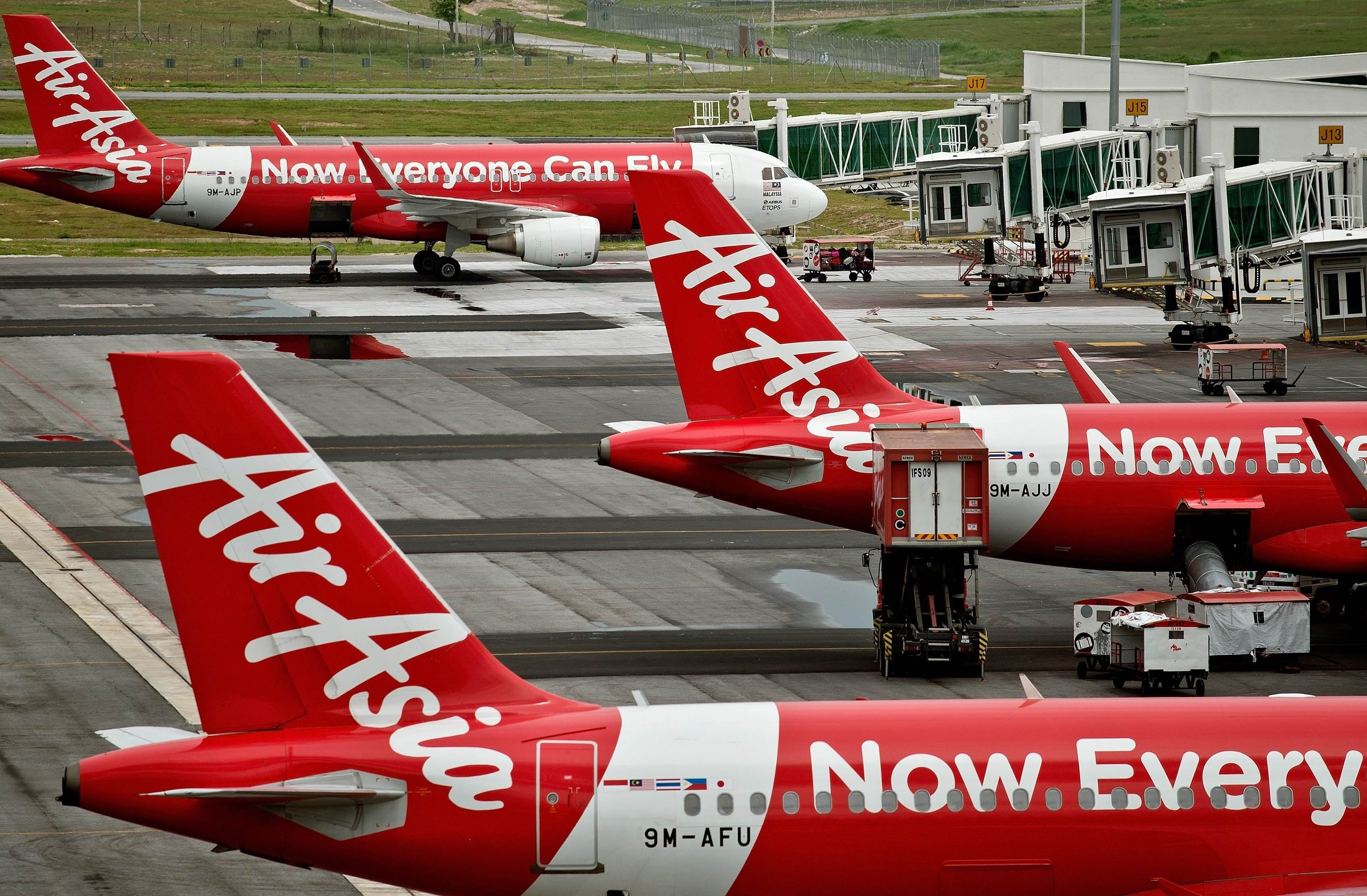 File- AirAsia Airbus A320 airplanes are parked on the tarmac at the low-cost carrier Kuala Lumpur International Airport 2 (KLIA2) in Sepang.  Photo: AFP