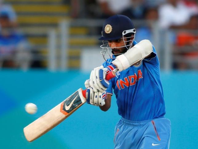 Ajinkya Rahane plays a shot during their Cricket World Cup match against Zimbabwe at Eden Park in Auckland, March 14, 2015. REUTERS/Nigel Marple/Files