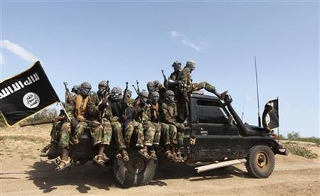 Members of al Shabaab, al Qaeda-linked insurgents, ride in a pick-up truck after distributing relief to famine-stricken internally displaced people at Ala Yaasir camp, outside Somalia's capital Mogadishu, September 3, 2011. nn REUTERS/Feisal Omar