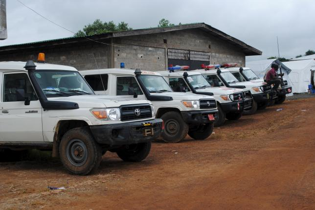 Ambulances are parked in Nedowein, Liberia, July 10, 2015. REUTERS/James Giahyue