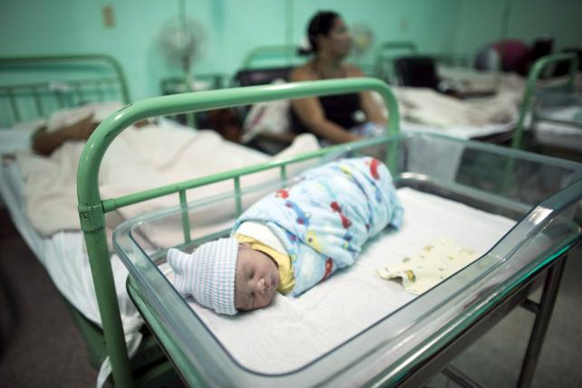 A new born baby rests beside his mother Dailyn Fleite (L), 29, at the Ana Betancourt de Mora Hospital in Camaguey, Cuba, June 19, 2015. REUTERS/Alexandre Meneghini