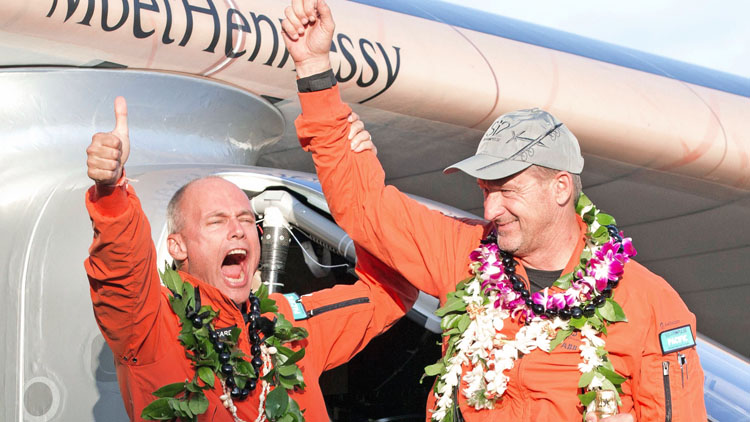 Solar Impulse 2 pilot Bertrand Piccard  (left) and pilot Andre Borschberg, celebrate after Borschberg landed at Kalaeloa Airport, Hawaii, on July 3, 2015. Solar impulse 2 is attempting to be the first solar powered airplane to fly around the world without using fuel. The airplane took off from Nagoya Japan on its eighth leg and flew non-stop before landing on Oahu.  The revolutionary Solar Impulse 2 aircraft completed an historic flight Friday after circling the globe without so much as a drop of fuel, then touching down seemingly effortlessly in Hawaii. The sun-powered plane, piloted by veteran Swiss aviator Andre Borschberg, spent five days to make the historic voyage, landing shortly after dawn at Kalaeloa Airport on the main Hawaiian island of Oahu. Photo: AFP