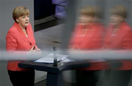 German Chancellor Angela Merkel gestures during her speech as part of a meeting of the German federal parliament, Bundestag, in Berlin, Germany, Friday, July 17, 2015. AP