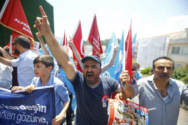 Demonstrators shout slogans during a protest against China near the Chinese Consulate in Istanbul, Turkey July 5, 2015. REUTERS/Osman Orsal