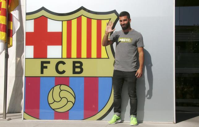 Arda Turan waves in front of the FC Barcelona headquarters before signing his contract in Barcelona, Spain July 9, 2015.  REUTERS/Gustau Nacarino