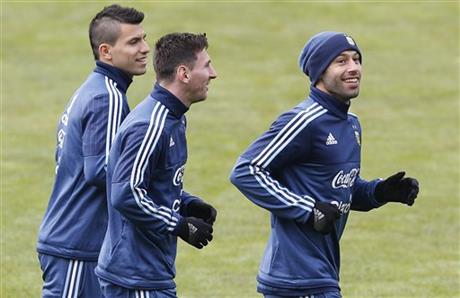 Argentina's Sergio Aguero, from left, Lionel Messi, and Javier Mascherano, jog during a training session in Concepcion, Chile, Wednesday, July 1, 2015. Argentina defeated Paraguay 6-1 on Tuesday and will face Chile in the final of Copa America soccer tournament Saturday. AP