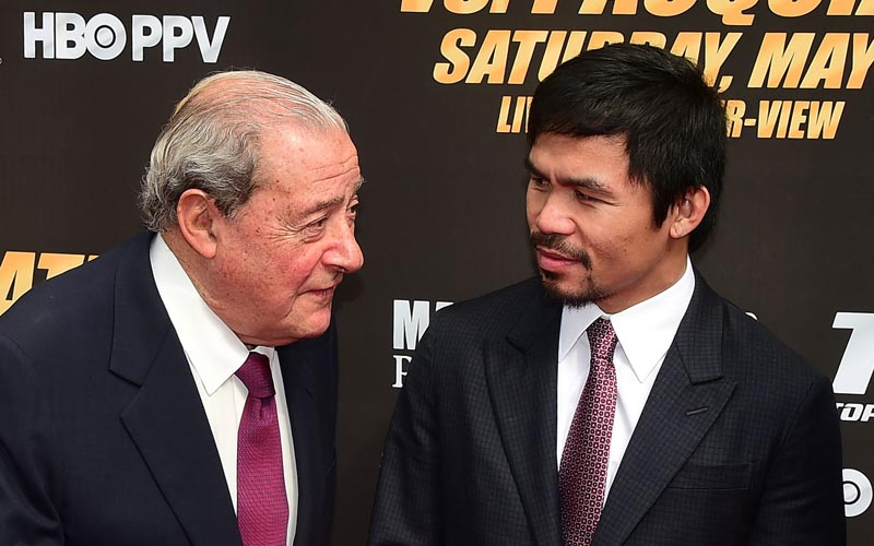 This file photo taken on March 11, 2015 shows Philippine boxer Manny Pacquiao listening while on the carpet with boxing promoter Bob Arum (left) on arrival in Los Angeles, California for the Floyd Mayweather vs Manny Pacquiao press conference ahead of their fight in Las Vegas. Manny Pacquiao downplayed criticism from promoter Bob Arum on July 20, 2015 after the injured Philippine boxing hero missed a doctor's visit for a shoulder injury, saying he was carrying out his own rehabilitation. Photo: AFP