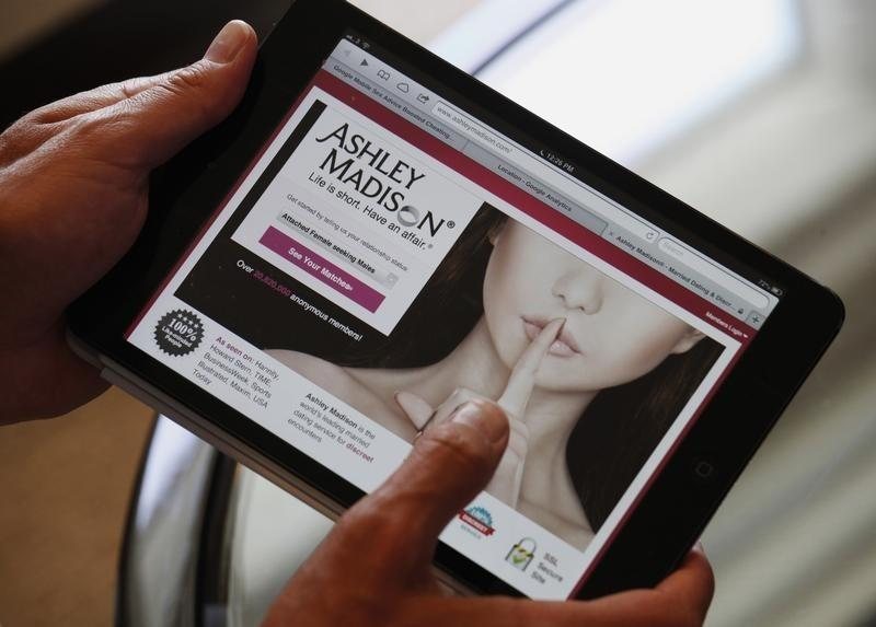 Ashley Madison founder Noel Biderman demonstrates his website on a tablet computer during an interview in Hong Kong August 28, 2013. Photo: Reuters
