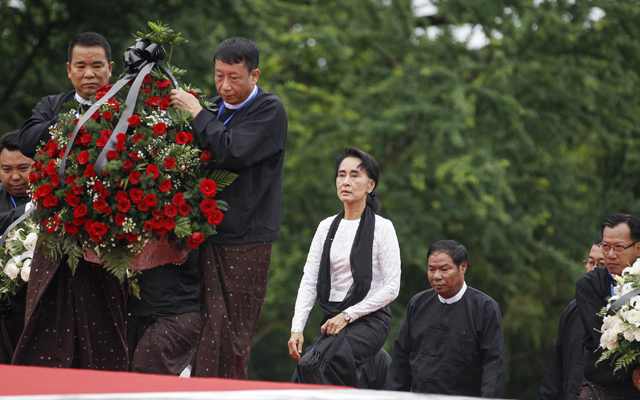 Myanmar's pro-democracy leader Aung San Suu Kyi (centre) attending an event marking the anniversary of Martyrs' Day at the Martyrs' Mausoleum, in Yangon, on Sunday. Photo: Reuters