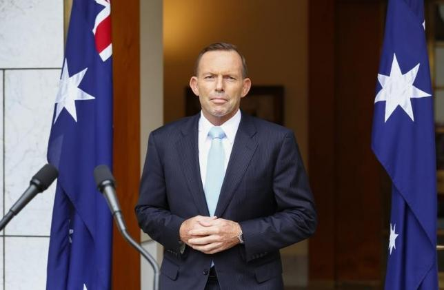 File- Australia's Prime Minister Tony Abbott addresses members of the media after a party room meeting at Parliament House in Canberra February 9, 2015. Photo: Reuters