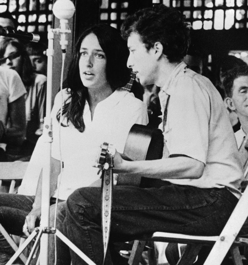 FILE - In this 1963 file photo, Joan Baez and Bob Dylan perform at the Newport Folk Festival in Newport, R.I. Two years later, on the night of July 25, 1965, Dylan strode onto a stage at the Newport Folk Festival, plugged in an electric guitar and gave the music world a shock. Photo: AP
