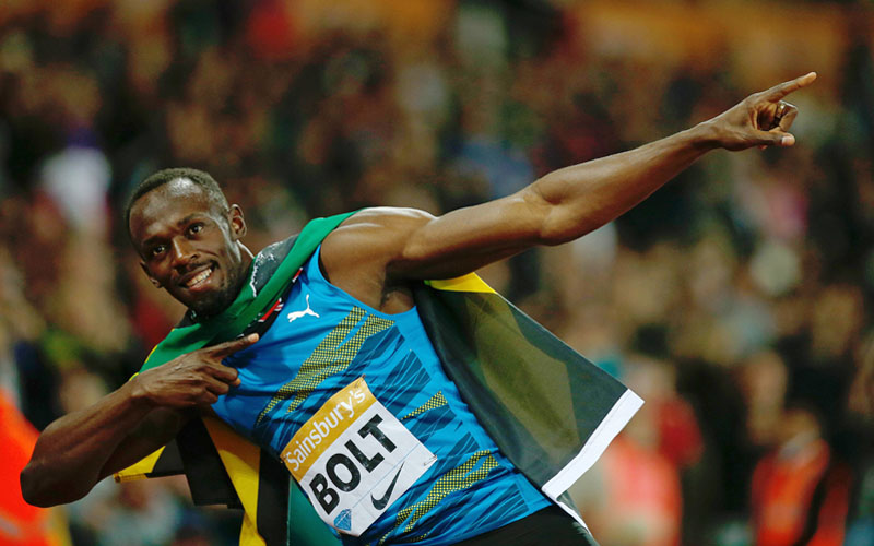 Jamaica's Usain Bolt celebrates after winning the 100m final at the IAAF Diamond League Anniversary Games athletics meeting in Stratford on Friday. Photo: AFP