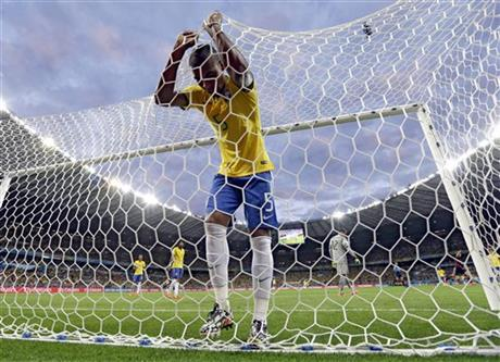 FILE - In this July 8, 2014, file photo, Brazil's Fernandinho reacts after Germany's Toni Kroos scored his side's third goal during the World Cup semifinal soccer match loss to Germany at the Mineirao Stadium in Belo Horizonte, Brazil. AP