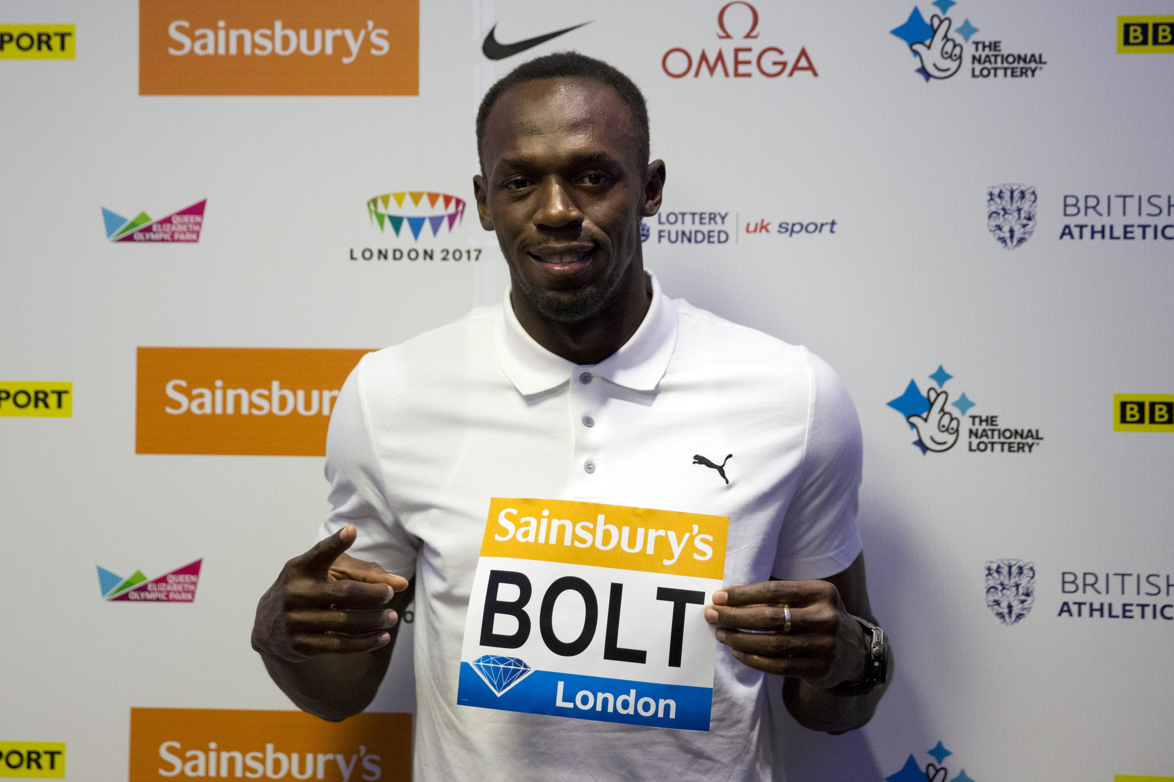 Jamaican sprinter Usain Bolt, the world record holder and Olympic champion in the 100 metres and 200 metres, poses for photographers at the end of a press conference in a hotel, ahead of competing in the Diamond League athletics meeting at the Olympic Stadium in London, Thursday, July 23, 2015.  Photo: AP