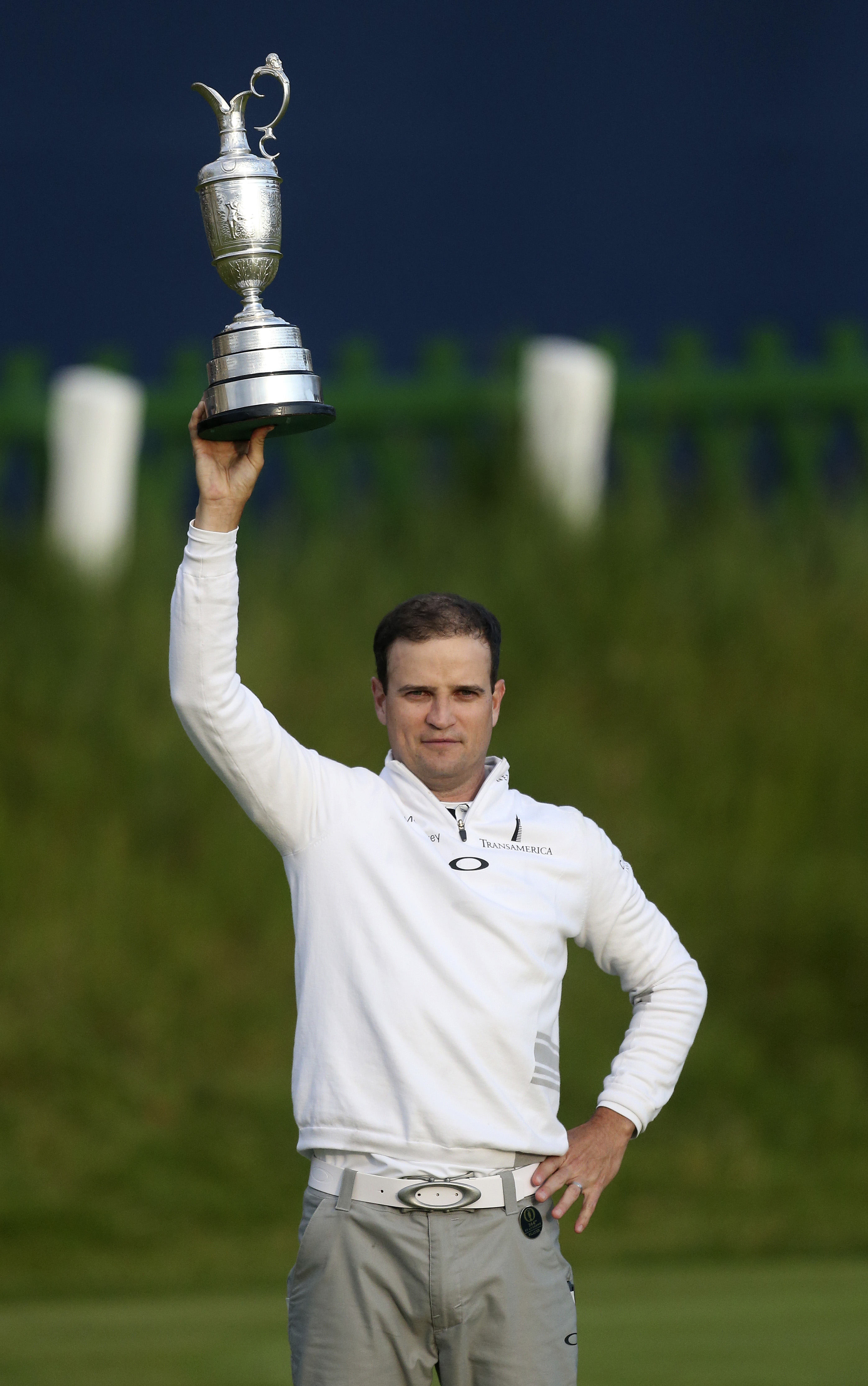 Zach Johnson of the United States holds aloft the trophy after winning the British Open Golf Championship at the Old Course in St Andrews, Scotland on Monday. Photo: AP
