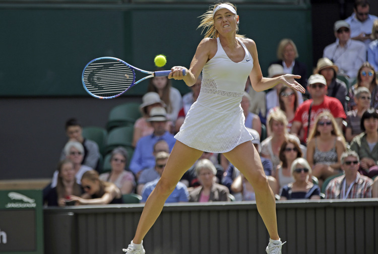 Maria Sharapova of Russia makes a forehand return against Coco Vandeweghe of the US during their Wimbledon match at the All England Lawn Tennis Championships in London on Tuesday. Photo: AP