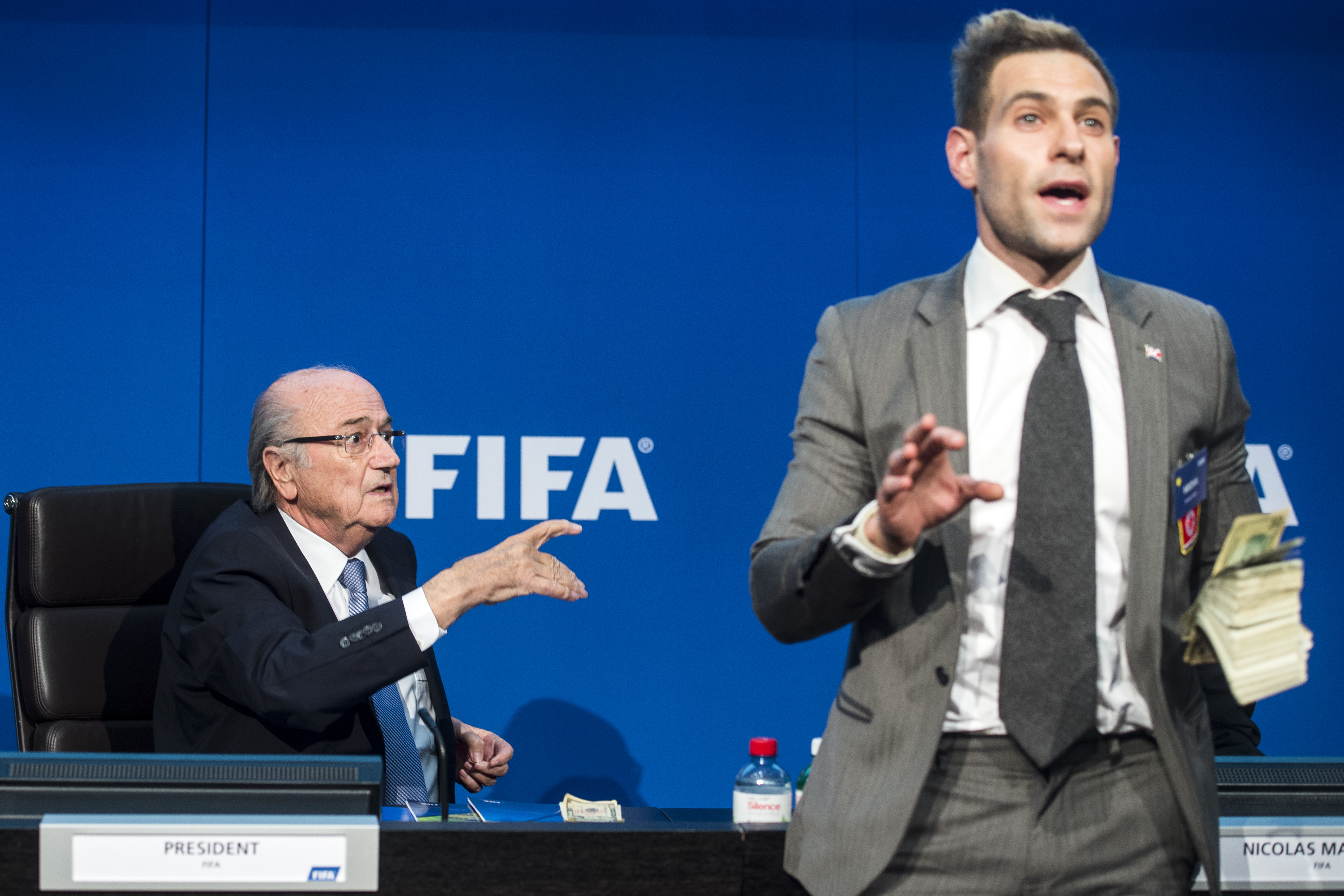 FIFA president Sepp Blatter (left) sitting next to British comedian Simon Brodkin during a press conference at the footballu2019s world governing body headquarters in Zurich on Monday. Photo: AP