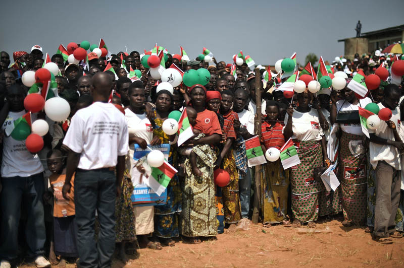 Supporters gather to watch  the Burundian president arrive at a ruling CNDD-FDD (National Council for the Defense of Democracyu0096Forces for the Defense of Democracy) party rally in Cibitoke Province on July 17, 2015. Photo: AFP