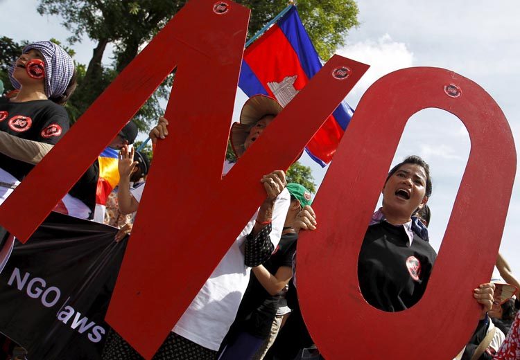 Protesters shout while they march to the Cambodia National Assembly during a protest in Phnom Penh July 13, 2015. Cambodia passed on Monday a contentious law to regulate non-governmental organisations (NGOs) which government critics fear will be used to muzzle opposition. REUTERS/Samrang Pring