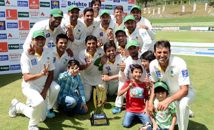 Pakistan players celebrate after winning the Test series against Sri Lanka at the Pallekele International Cricket Stadium on Tuesday. Photo: AFP