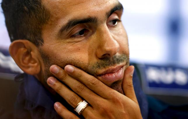 Argentina's Carlos Tevez attends his presentation as Boca Juniors' new player in Buenos Aires July 13, 2015. Tevez was officially unveiled on Monday in a 6.5 million euros ($7.15 million) transfer from Juventus. Thousands of fans of the popular club from the port district of La Boca packed La Bombonera stadium to welcome Tevez home from a decade abroad the day after the team went top of the Argentine league championship. REUTERS/Marcos Brindicci