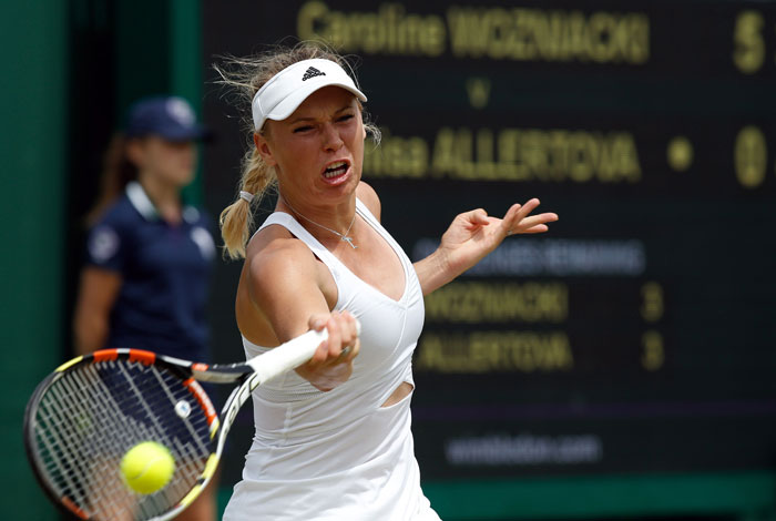 Denmark's Caroline Wozniacki returns to Czech Republic's Denisa Allertova during their women's singles second round match on day four of the 2015 Wimbledon Championships at The All England Tennis Club in Wimbledon, southwest London, on July 2, 2015.  Photo: AFP