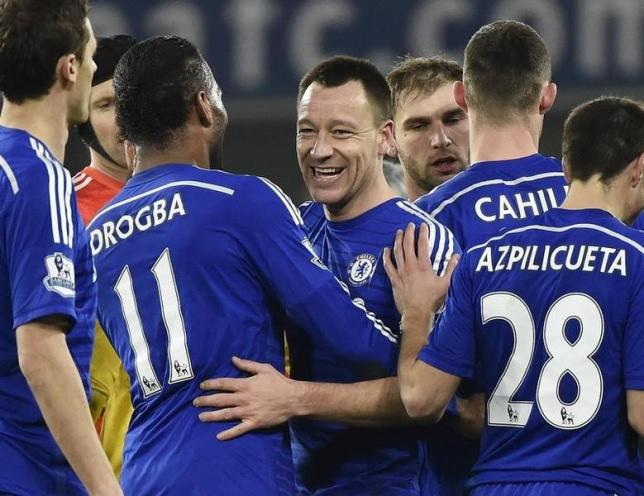 John Terry (C) of Chelsea celebrates after they defeated Everton in their English Premier League soccer match at Stamford Bridge, London, February 11, 2015.           REUTERS/Toby Melville