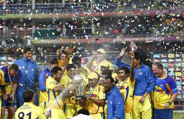 Chennai Super Kings players celebrate with the trophy after winning the Champions League T20 cricket tournament in Johannesburg September 26, 2010. REUTERS/Siphiwe Sibeko/Files