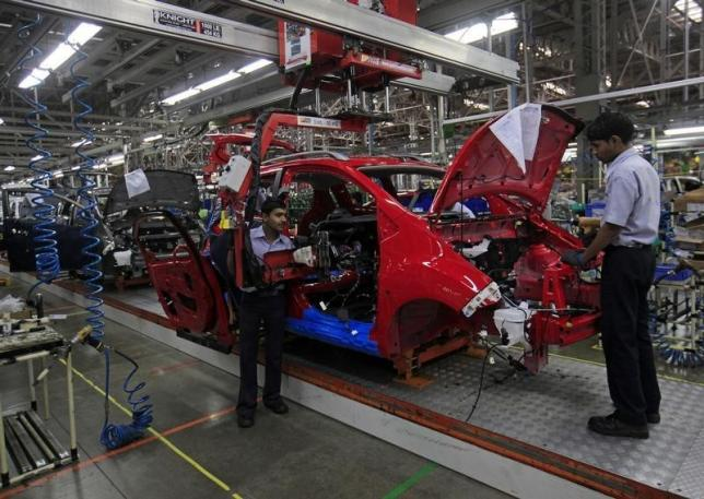 Employees work on a Chevrolet Beat car on an assembly line at the General Motors plant in Talegaon, about 118 km (73 miles) from Mumbai September 3, 2012.  Photo: Reuters