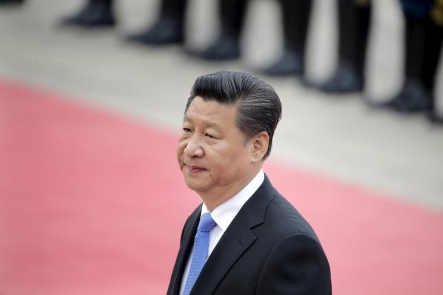 China's President Xi Jinping attends a welcoming ceremony for Angola's President Jose Eduardo Dos Santos outside the Great Hall of the People in Beijing, June 9, 2015. REUTERS/Jason Lee