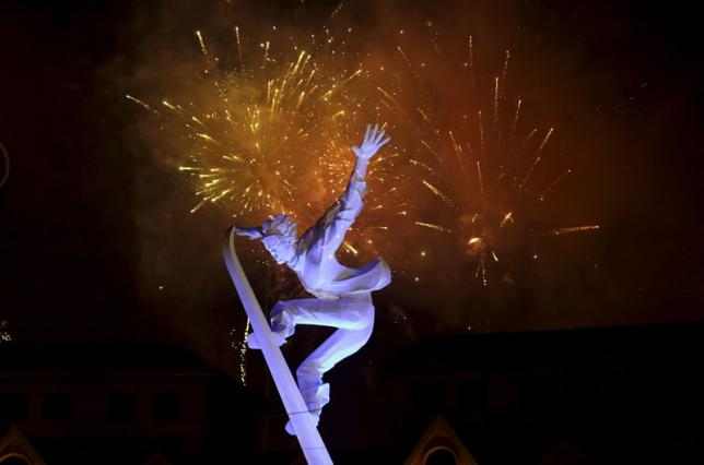 Fireworks explode behind a snowboarding sculpture to celebrate Beijing being chosen to host the 2022 Winter Olympics, in Chongli county of Zhangjiakou, jointly bidding to host the 2022 Winter Olympic Games with capital Beijing, July 31, 2015.   REUTERS/Jason Lee